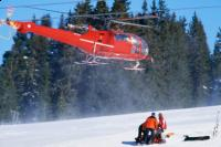 Helicopter arriving after ski accident - covered or not covered?